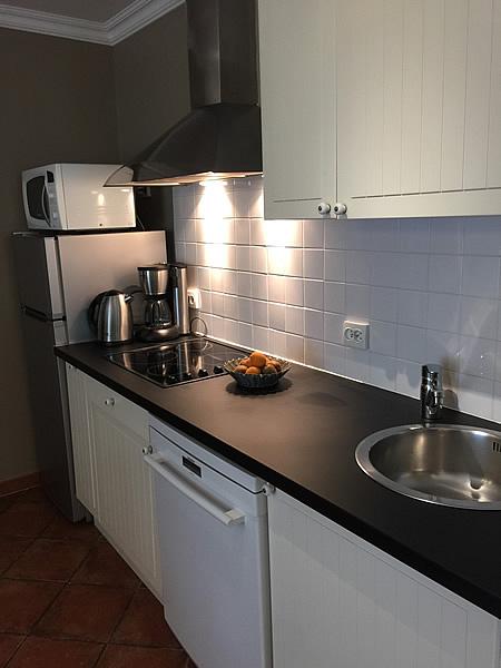 The kitchen has a cooker, fridge/freezer, dishwasher, etc