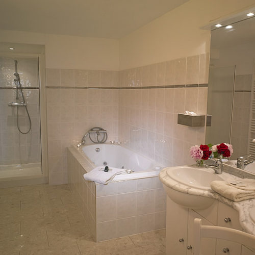 Bathroom with a jacuzzi bath and separate shower
